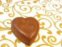 Mouthwatering chocolates in a heart-shaped Stock Photography