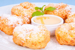 Mouthwatering donuts sprinkle with powdered sugar. Mouthwatering donuts sprinkle with powdered sugar sweet syrup on the plate Stock Photos