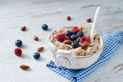 Mouthwatering fresh berries with cereal. Mouthwatering fresh and ripe berries with cereal and almond Royalty Free Stock Photography