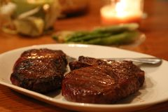 Mouthwatering Grilled Steak. For a cozy candlelight dinner. Asparagus on the side compliments this dinner perfectly Royalty Free Stock Photography