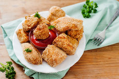 Mouthwatering nuggets with ketchup and parsley Stock Photos