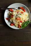 Mouthwatering pasta with brie cheese and Parmesan Royalty Free Stock Images
