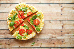 Mouthwatering pizza with tomatoes, top view. Food Royalty Free Stock Images