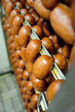 Mouthwatering smoked sausages on the background of a meat factory. Or butcher shop Stock Photography