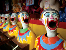 Mouthy clowns. A row of clowns at an amusement park game royalty free stock images