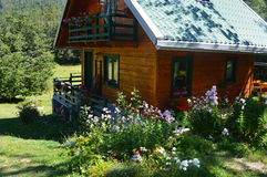 Moutines house, log cabin, wilderness, flowers, live in the village Stock Photo