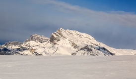 Moutnain Peak in Winter. Beautiful rocky mountain peak covered by snow over a ski slope in the Alps in Mont Blanc Massif Royalty Free Stock Photography