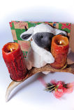Moutons de jouet avec des bougies Photos stock