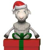 Moutons debout de sourire avec Santa Claus Hat et le boîte-cadeau Image libre de droits