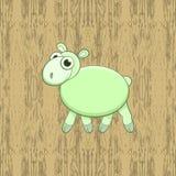 Moutons verts de bande dessinée sur le fond en bois Image stock