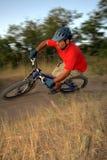 Mouvement de journal sur un vélo images libres de droits