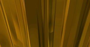 Mouvement matériel vertical d'écoulement de mouvement de vagues abstraites d'or, fond métallique d'or,