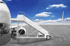 Movable boarding ramp near the entrance to the passenger airplan Royalty Free Stock Image