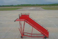 Movable boarding ramp for passenger is waiting for airplane. Royalty Free Stock Photos