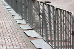 Movable metal barriers. On a city street Stock Photography