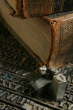 Movable type with old book Royalty Free Stock Image