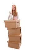 We move!. Girl, cardboard boxes and a kitten on a white background Royalty Free Stock Images