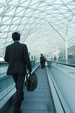On the move. Businessman in Milan, Italy - Motion blur, slight noise & cross-processing Royalty Free Stock Photo