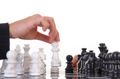 Move. Chessplayer making a move on a beautiful marble chessboard Royalty Free Stock Photos