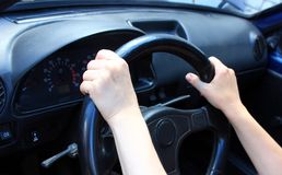 Always on the move. Close-up of female hands on steering wheel Stock Photos