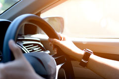 Always on the move. Close-up of hands on steering wheel Royalty Free Stock Images
