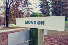 Move on concept with a rural signboard in an autumn landscape Royalty Free Stock Images