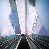 Moving escalator in modern building Stock Photo
