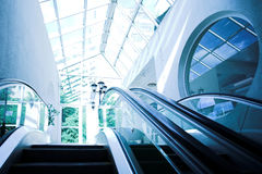 Moving escalator in modern office Royalty Free Stock Images