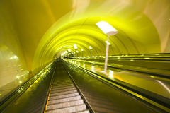 Move escalator in modern office centre. Yellow move escalator in modern office centre Stock Photos