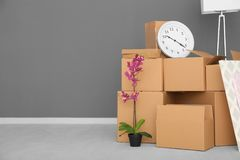 Move house concept. Carton boxes and belongings. On floor in empty room Royalty Free Stock Images