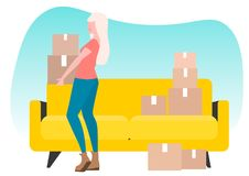 The girl takes the box. Move. Housewarming. Girl s moving. Yellow couch. A lot of boxes Royalty Free Stock Image