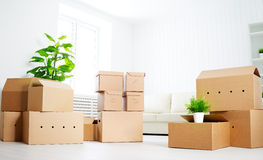 Move. lots of cardboard boxes in empty new apartment Stock Photos