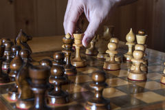 Move the main figure. Move white piece in a chess game Royalty Free Stock Image