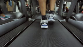 Move motion athlete on a treadmill at the gym is stock video footage