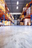 Move motion in warehouse. Low angle Move motion in warehouse Royalty Free Stock Photography