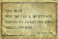 Move mountain print. The man who moves mountain - ancient Chinese philosopher Confucius quote printed on grunge vintage cardboard Stock Image