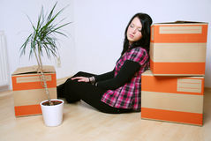 Move in new home. Young woman fall asleep while on the move Royalty Free Stock Photo