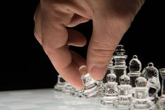 Move the pawn. Hand holding the  pawn to make the first move Royalty Free Stock Image