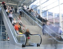 Move people on escalator Stock Images