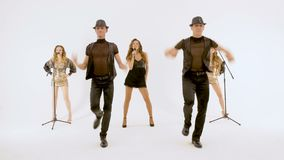 A group of professional actors dancing on a white background. They move synchronously, all movements are very plastic. They move synchronously, all movements are stock footage