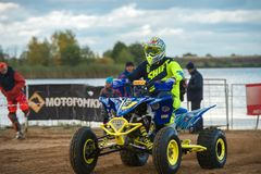 Move to the start line. SERPUKHOV, RUSSIA - OCTOBER 7, 2017: Yarovoy Evgeniy 6,  Class ATV, in the 4 stage  MX series, the Red Wings Cup 2017 super country-cross Royalty Free Stock Photos