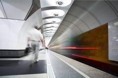 Move train on platform in subway Stock Photos