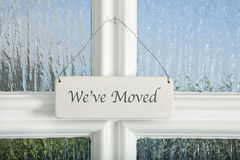 Moved shield. A sign on a door with the text we have moved Royalty Free Stock Photo