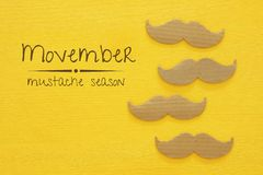 Movember cancer awareness event concept over wooden background. Top view Royalty Free Stock Photography