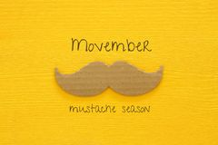 Movember cancer awareness event concept over wooden background. Top view Stock Photo