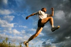 Movement. Man prepares for jump on a sky background Stock Photo