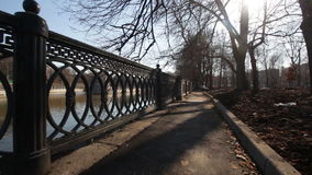 Movement along the fence of the urban river. Moscow stock video footage