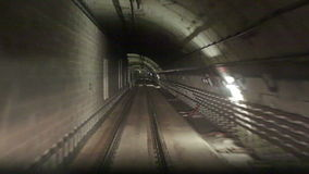 Movement along the rails. In the subway tunnel stock footage