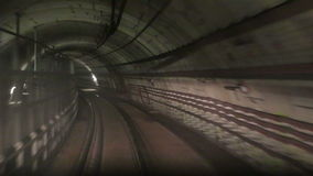 Movement along the rails. In  subway tunnel stock video