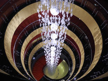 Movement around a rod that emits light. The chandelier in the center of the circles and spirals Stock Images